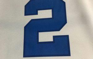 Il logo Unibed sul retro della maglia gara l'Enel Brindisi
